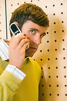 A suspicious looking early 30's Caucasian businessman talking on his cell phone.20050916_MR_D.20050916_PR_A