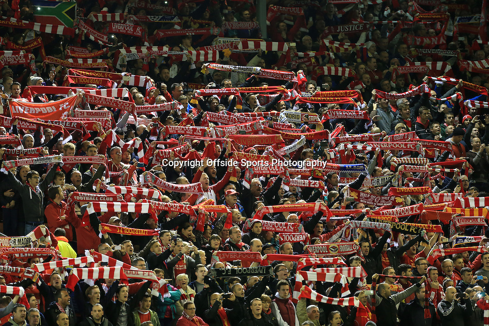 22nd October 2014 - UEFA Champions League - Group B - Liverpool v Real Madrid - Liverpool fans hold their scarves aloft - Photo: Simon Stacpoole / Offside.
