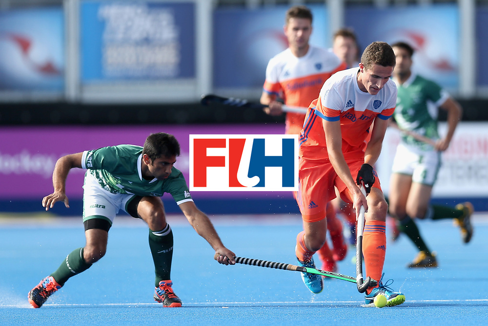 LONDON, ENGLAND - JUNE 15: Niwaz Ashfaq of Pakistan attempts to tackle Jonas de Geus of the Netherlands during the Hero Hockey World League Semi Final match between India and Scotland at Lee Valley Hockey and Tennis Centre on June 15, 2017 in London, England.  (Photo by Alex Morton/Getty Images)