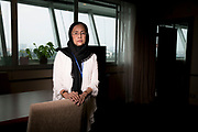 Angkhana Neelaphaijit stands in by the window in her office at the Human Rights Commission of Thailand.<br /> <br /> She is a Thai human rights activist and Commissioner of the Thai Human Rights Commission and the wife of disappeared human rights lawyer Somchai Neelaphaijit. In March 2004 her husband was abducted in central Bangkok and never seen again whilst he was defending a group men from the South of Thailand who were arrested on terrorism charges and claimed they were tortured in police custody.The people involved were never charged with anything more than coercion and gang-robbery as the body of Somchai Neelaphaijit was never found. <br /> <br /> She was a nurse and a housewife when her husband was abducted and since that day, during her 11 years long fight for justice on behalf of her husband, she has risen to become the Commissioner of the Thai Human Rights Commission.