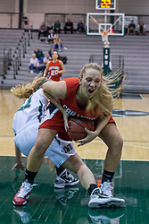 29 January 2011: Kristi Schmidt gets possession of a loose ball during an NCAA Womens basketball game between the Carthage Reds and the Illinois Wesleyan Titans at Shirk Center in Bloomington Illinois.