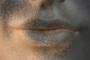close up of mannequin lips spray painted with black paint