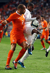 John Heitlnga (NED) and Ashley Young (ENG) compete for the ball during the International Friendly between Netherlands and England at the Amsterdam Arena on August 12, 2009 in Amsterdam, Netherlands.