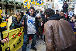 London, UK. 22nd January, 2019. Petros Elia, General Secretary of United Voices of the World, dances on the picket line as receptionists, security guards and cleaners at the Ministry of Justice (MoJ) begin a strike for the London Living Wage of £10.55 per hour and parity of sick pay and annual leave allowance with civil servants. The strike is being coordinated with support staff at the Department for Business, Energy and Industrial Strategy (BEIS) from the Public and Commercial Services (PCS) union.