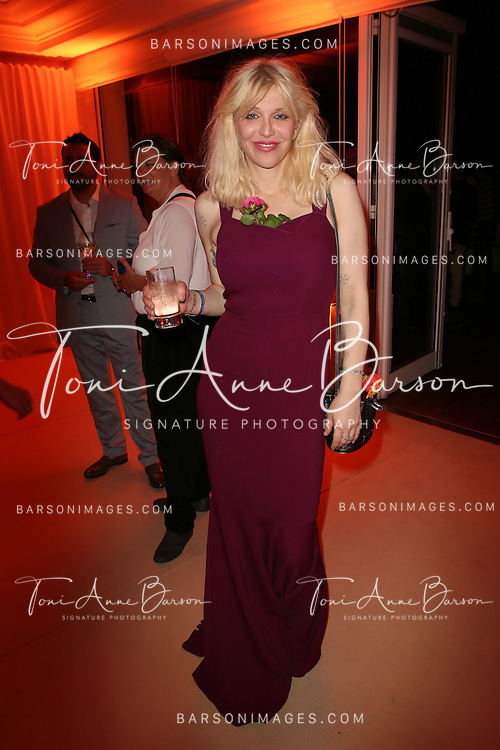 CAP D'ANTIBES, FRANCE - JUNE 17:  Courtney Love attends Clear Channel Media And Entertainment And MediaLink Dinner at Hotel du Cap-Eden-Roc on June 17, 2014 in Cap d'Antibes, France.  (Photo by Tony Barson/Getty Images for Clear Channel)