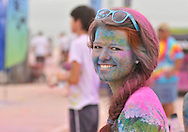 Alex Dullea is covered in a variety of colored powders after completing the Color Me Rad 5K Run in the parking lot of the Freeman Coliseum.