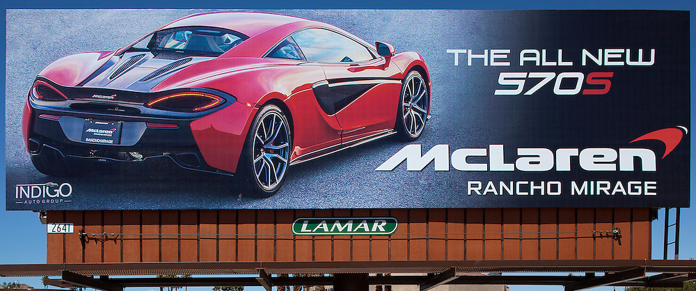 McLaren P570S sports car on Billboard advertisment for Desert European Motor Cars and Indigo motor group.