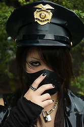 Young girl dressed as goth at Harajuku in central Tokyo Japan