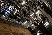 The fly tower with trusses and poles for lights and backdrops of the Shakespeare hall at Elfo-Puccini Theatre, Milan. On the left some ropes to raise and lower trusses and backdrops. © Carlo Cerchioli..La torre scenica con i tralicci e pali per le luci e i fondali alla sala Shakespeare del Teatro Elfo-Puccini, Milano. A sinistra alcune corde per sollevare ed abbassare tralicci e fondali.