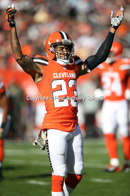 Cleveland Browns cornerback Joe Haden (23) has a laugh as he raises his arms in celebration after a play during the 2015 week 8 regular season NFL football game against the Arizona Cardinals on Sunday, Nov. 1, 2015 in Cleveland. The Cardinals won the game 34-20. (©Paul Anthony Spinelli)