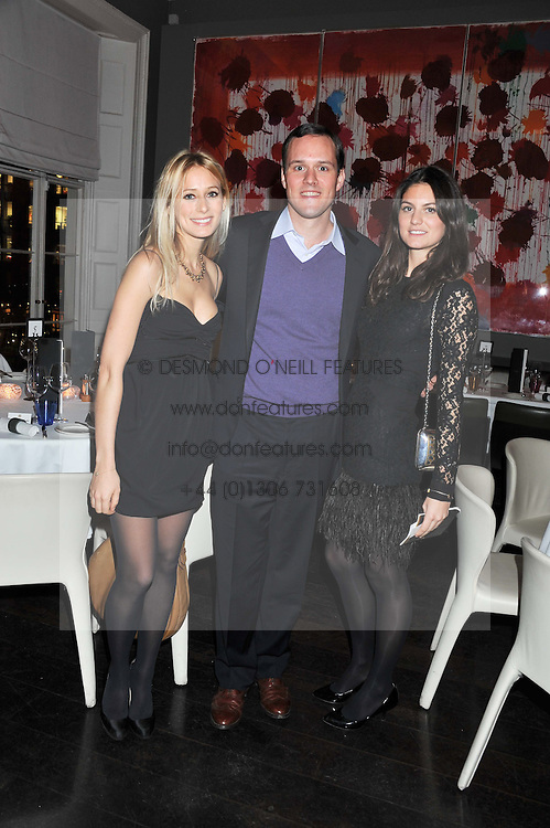 Left to right, KATHERINE HOLMGREN, ANDREW LITTLEJOHN and SOPHIA BRENNINKMEYER at a dinner for the Serpentine Gallery's Council held at Morton's, Berkeley Square, London on 5th December 2011.