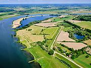 Nederland, Gelderland, Culemborg; 27-05-2020; Beusichemsedijk direct ten oosten van Culemborg en even voor de Afgravingen Culemborg (in de bocht van de rivier). Na het hoogwater van 1995 is de dijk versterkt en verbeterd.<br /> Beusichemsedijk immediately east of Culemborg and just before the 'Culemborg Digs' (in the bend of the river). After the flood of 1995, the dike was strengthened and improved.<br /> <br /> luchtfoto (toeslag op standaard tarieven);<br /> aerial photo (additional fee required)<br /> copyright © 2020 foto/photo Siebe Swart