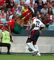 STADIO  DA LUZ  LISBON PORTUGAL 24/06/04  ENGLAND V PORTUGAL  EURO 2004<br /> DARIUS VASSELL (ENGLAND)<br /> (JORGE ANDRADE PORTUGAL)<br /> (Photo Roger Parker Digitalsport