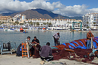 Fishermen repair fishing nets, quay, Mediterranean, Mediterraneo, Estepona, Malaga, Andalucia, Andalusia, Spain, Espana, Costa del Sol, tourism, travel, holidays, 201302201117..Copyright Image from Victor Patterson, 54 Dorchester Park, Belfast, UK, BT9 6RJ..Tel: +44 28 9066 1296.Mob: +44 7802 353836.Voicemail +44 20 8816 7153.Skype: victorpattersonbelfast.Email: victorpatterson@me.com.Email: victorpatterson@ireland.com (back-up)..IMPORTANT: If you wish to use this image or any other of my images please go to www.victorpatterson.com and click on the Terms & Conditions. Then contact me by email or phone with the reference number(s) of the image(s) concerned.