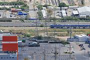 Passenger train passes through the industrial zone of Haifa Bay, Israel