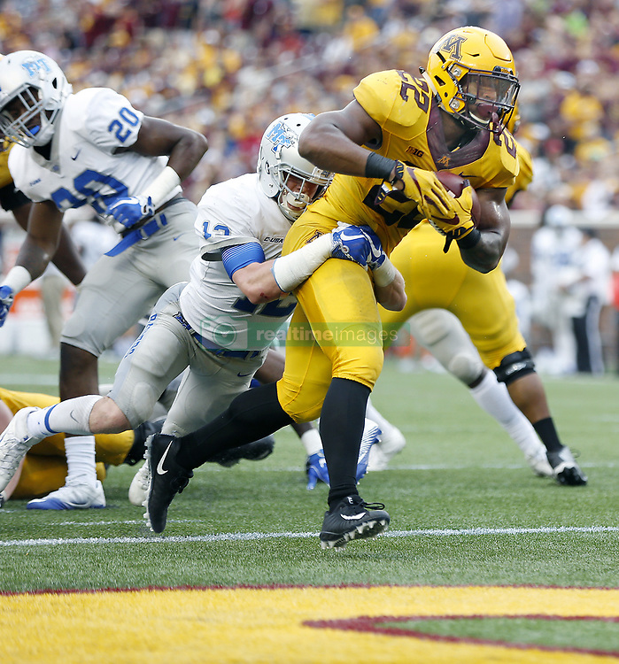 September 16, 2017 - Minneapolis, MN, USA - Minnesota running back Kobe McCrary (22) plows into the end zone, taking Middle Tennessee defensive back Reed Blankenship with him for a 5-yard touchdown run during the fourth quarter at TCF Bank Stadium, Saturday, Sept. 16, 2017, in Minneapolis. The host Gophers won, 34-3. (Credit Image: © Elizabeth Flores/TNS via ZUMA Wire)
