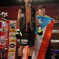 Daniel Rosario is seen in his corner prior to his fight against Alphonso Black during a Telemundo Boxeo boxing match at the A La Carte Pavilion on Friday,  March 13, 2015 in Tampa, Florida.  (AP Photo/Alex Menendez)