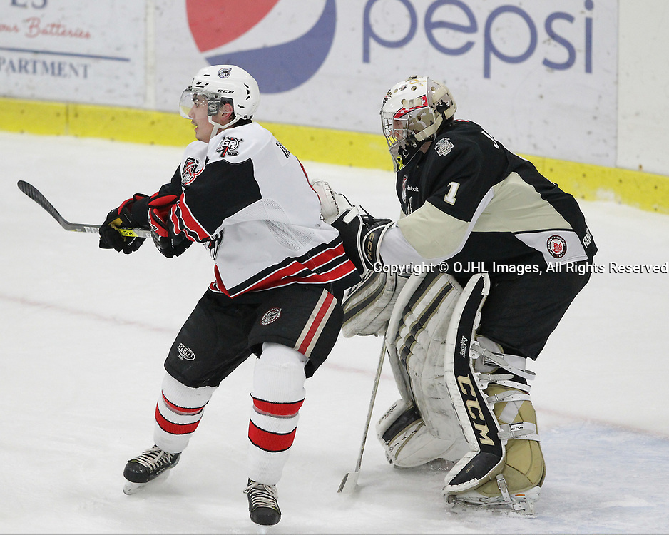 GEORGETOWN, ON  - APR 18,  2017: Ontario Junior Hockey League, Championship Series. Georgetown Raiders vs the Trenton Golden Hawks in Game 3 of the Buckland Cup Final. Ryan Takamatsu #8 battles for position during the first period as Chris Janzen #1 follows the play during the first period.<br /> (Photo by Tim Bates / OJHL Images)