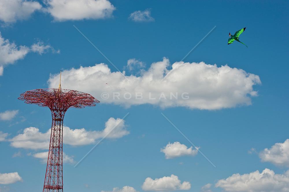 Parachute amusement ride and a dragon kite flying at Coney Island NYC