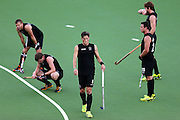 Simon Child of New Zealand looks on with the team during the bronze medal match between New Zealand and England. Glasgow 2014 Commonwealth Games. Hockey, Bronze Medal Match, Black Sticks Men v England, Glasgow Green Hockey Centre, Glasgow, Scotland. Sunday 3 August 2014. Photo: Anthony Au-Yeung / photosport.co.nz