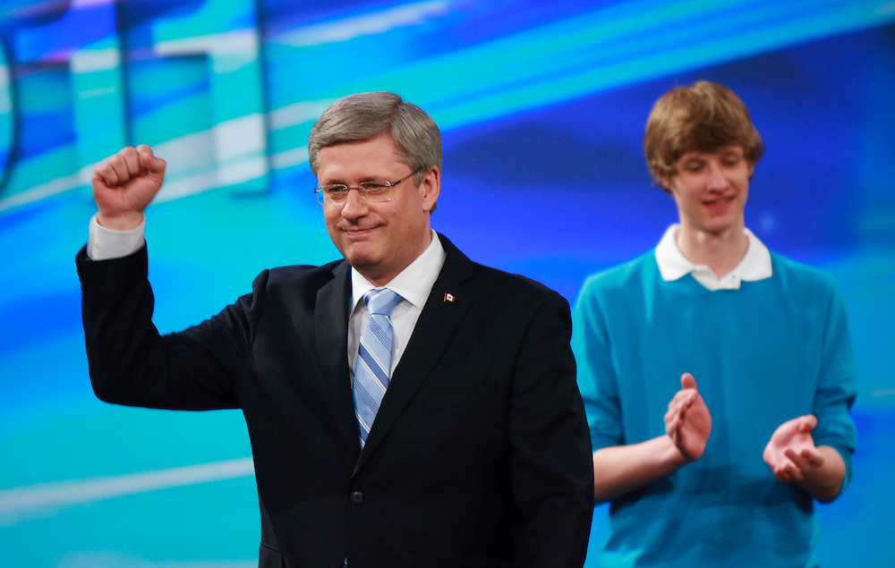 Conservative leader Stephen Harper waves to supporters gathered at the Telus Convention Centre in Calgary, Alberta, May 2, 2011 as he celebrates the election of a Conservative majority government in the federal election.<br /> AFP/GEOFF ROBINS/STR