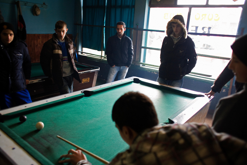 Albanian boys play at a club for youth that includes billiards tables, table soccer and video games...Mitrovica, February 15, 2009.