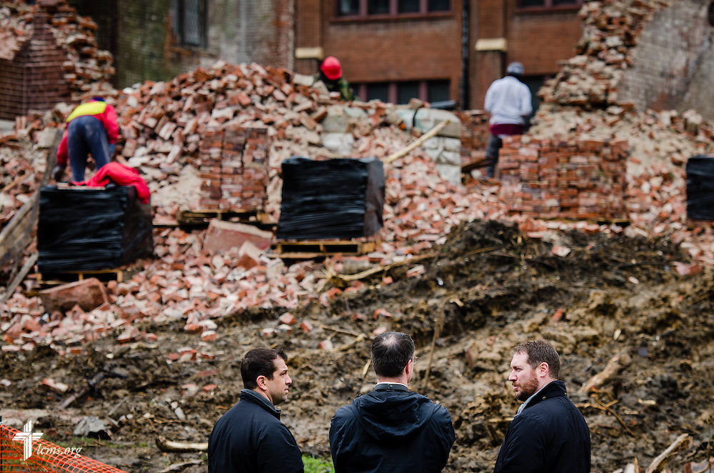 (L-R) The Rev. Ross Johnson, LCMS director of Disaster Response, the Rev. Steven Schave, director of LCMS Urban & Inner-City Ministry, and the Rev. Michael W. Meyer, manager of LCMS Disaster Response, survey the damage as workers remove debris from Bethlehem Lutheran Church in north St. Louis on Monday, April 14, 2014. The 119 year-old church collapsed on Friday evening.  LCMS Communications/Erik M. Lunsford