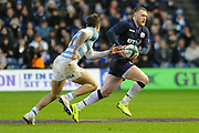 Stuart Hogg under pressure during the Autumn Test match between Scotland and Argentina at Murrayfield, Edinburgh, Scotland on 24 November 2018.