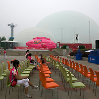 BEIJING, AUGUST 6 :  a volunteer sits in one of the public places where Beijingers can watch live broadcasts of the Olympic Games.