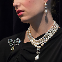 "© Licensed to London News Pictures. 19/10/2018. LONDON, UK. A model wears Marie Antoinette's jewels comprising (L to R) a diamond brooch, second half of the 18th century (Est. USD 50k-80k), a natural pearl and diamond necklace comprising three rows of 116 graduated pearls (Est USD200k-300k), a natural pearl and diamond necklace (Est USD40k-70k), ""Queen Marie Antoinette's Pearl"", a natural pearl and diamond pendant 18th century set (Est USD1m-2m), and a pair of natural and pearl diamond pendant earrings, late 18th century (Est USD200k-300k).  Preview of Sotheby's ""Royal Jewels from the Bourbon-Parma Family"", a family descended from Louis XIV of France, the Holy Roman Emperors and from Pope Paul III, with links to the most important ruling families of Europe. Led by a breath-taking group of jewels which once belonged to Marie Antoinette, queen of France, the collection of jewels will be offered for sale at Sotheby's in Geneva on 14 November 2018.  Photo credit: Stephen Chung/LNP"