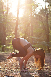 Woman Practicing Yoga in a Forest, Crow Pose