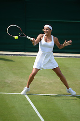 © Licensed to London News Pictures. 24/06/2014. London, UK . Wimbledon Tennis Championships 2014<br /> Day 2. Heather Watson, GBR during her defeat of Ajla Tomljanovic, CRO Photo credit : Mike King/LNP