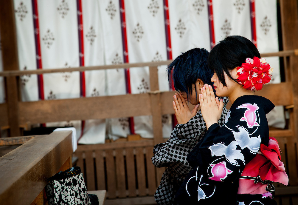 People pray at Tsurugaoka Hachimangū, a Shinto shrine in Kamakura, Kanagawa Prefecture, Japan.