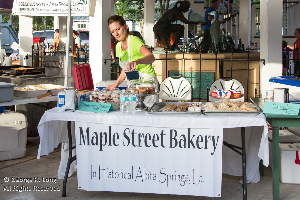 The Maple Street Bakery sells baked goods to people gathering in Abita Springs Park before fireworks on July 2, 2017