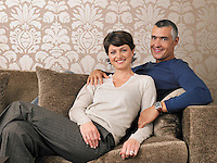 Married Couple Relaxing on Sofa