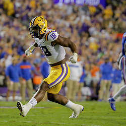 Oct 12, 2019; Baton Rouge, LA, USA; LSU Tigers linebacker K'Lavon Chaisson (18) reacts after a defensive stop against the Florida Gators during the first quarter at Tiger Stadium. Mandatory Credit: Derick E. Hingle-USA TODAY Sports