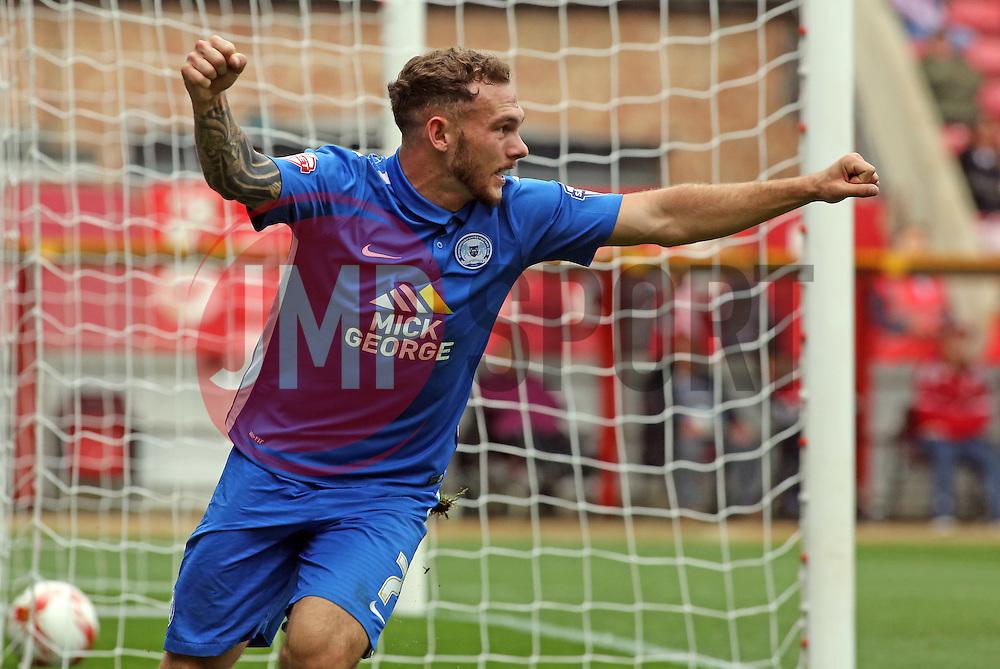 Jon Taylor of Peterborough United celebrates scoring the opening goal - Mandatory byline: Joe Dent/JMP - 07966 386802 - 10/10/2015 - FOOTBALL - County Ground - Swindon, England - Swindon Town v Peterborough United - Sky Bet League One