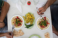 Telecom worker's breakfast. Hummus served with pickles, hot chilies and flat bread. Antakya, Hatay, Turkey