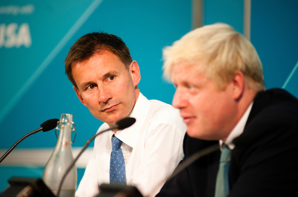 London, UK - 13 August 2012: Culture Secretary, Jeremy Hunt and Mayor Boris Johnson during the final press conference of the Olympic Games to discuss the success of London 2012.
