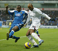 Photo: Aidan Ellis.<br /> Bolton Wanderers v Wigan Athletic. The Barclays Premiership. 04/11/2006.<br /> Wigan's Emerson Boyce (L) blocks the cross from Bolton's Nicolas Anelka
