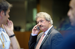 Jean Asselborn, Luxembourg's foreign minister, speaks on his mobile phone before the start of the European Summit, in Brussels, Thursday, June 18, 2009. (Photo © Jock Fistick)
