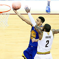 10 June 2016: Golden State Warriors guard Stephen Curry (30) goes for the layup past Cleveland Cavaliers guard Kyrie Irving (2) during the Golden State Warriors 108-97 victory over the Cleveland Cavaliers, during Game Four of the 2016 NBA Finals at the Quicken Loans Arena, Cleveland, Ohio, USA.