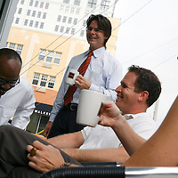 ST. PETERSBURG, FL -- July 01, 2008 -- Bob Devin Jones, left to right, Kevin Dami, Kevin Lane, and Robin O'Dell share a laugh during a low-key business meeting about The Studio@620 gallery, which Jones is the artistic director of, at the Kahwa Coffee Roasting retail cafe and espresso bar in downtown St. Petersburg, Fla., stand for a portrait outside of their cafe on Tuesday, July 01, 2008.  St. Petersburg's downtown is thriving with new shops, restaurants, and bars that are feeding off a younger, energetic crowd that fills its walkable map pinpointed with rejuvenated historic hotels and condos.