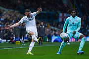 Leeds United defender Stuart Dallas (15) passes the ball during the EFL Sky Bet Championship match between Leeds United and Queens Park Rangers at Elland Road, Leeds, England on 2 November 2019.