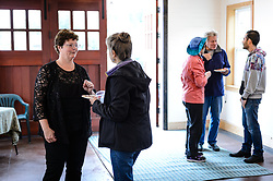 Phyllis Sage (left) greets Sue Nelson of Haines to the open house for the recently restored fire hall located on the grounds of historic Fort William H. Seward in Haines, Alaska.<br /> <br /> The fire hall was restored over a two-year period by owners Sage and Joanne Waterman who also own the fort&rsquo;s original guardhouse, now a bed and breakfast, located next door to the fire hall.<br /> <br /> After being absent from the historic Fort Seward skyline since approximately the 1930s, the 60-foot tower of the fort&rsquo;s fire hall has been restored to its original height. The building and tower, built around 1904 in Haines, Alaska, was shortened to approximately half its height in the 1930s for unknown reasons. The restoration included rebuilding a missing 35-foot section of the 60-foot tower whose purpose was to dry fire hoses. The tower restoration was completed by building its four sections on the ground and then hoisting those sections with a crane into place on top of each other.<br /> <br /> Through the years, the historic Fort Seward area, a former U.S. Army post, has been referred to as Fort William H. Seward, Chilkoot Barracks, and Port Chilkoot. The National Historic Landmarks listing record for the fort says that &quot;Fort Seward was the last of 11 military posts established in Alaska during the territory's gold rushes between 1897 and 1904. Founded for the purpose of preserving law and order among the gold seekers, the fort also provided a U.S. military presence in Alaska during boundary disputes with Canada. The only active military post in Alaska between 1925 and 1940, the fort was closed at the end of World War II.&rdquo; <br /> <br /> The bottom portion of the fire hall is being leased as commercial space. Due to fire code restrictions there is no public access to the upper portion of the tower.