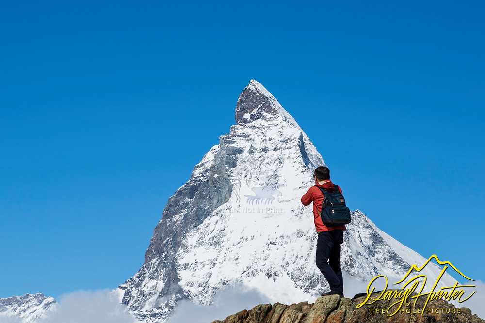 Photographer shooting the Matterhorn it Zermatt Switzerland