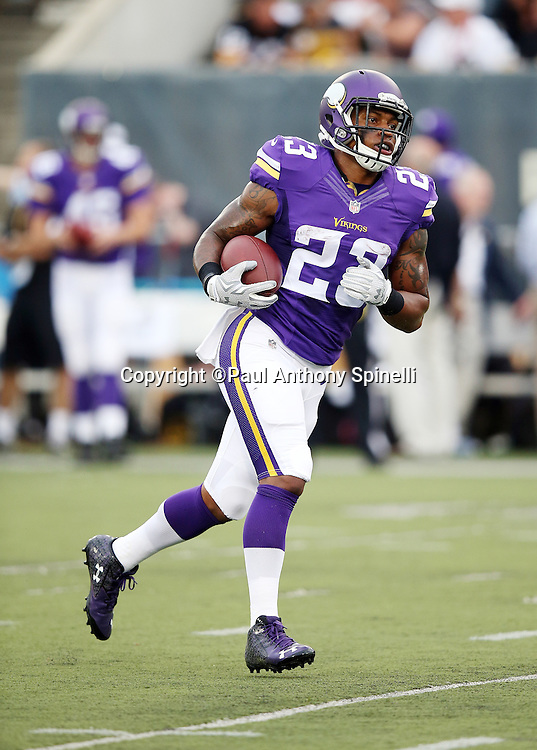 Minnesota Vikings running back Joe Banyard (23) runs the ball during pregame warmups before the 2015 NFL Pro Football Hall of Fame preseason football game against the Pittsburgh Steelers on Sunday, Aug. 9, 2015 in Canton, Ohio. The Vikings won the game 14-3. (©Paul Anthony Spinelli)