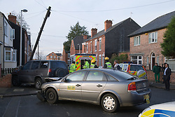Emergency services attending a road traffic accident in a side street in Nottingham,