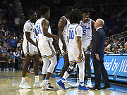 Nov 6, 2019; Los Angeles, CA, USA; UCLA Bruins head coach Mick Cronin, right, talks with guard Prince Ali (23), guard David Singleton (34), guard Tyger Campbell (10), forward Jalen Hill (24) and guard Chris Smith (5) in the second half against Long Beach State at Pauley Pavilion. UCLA defeated Long Beach State 69-65 in Cronin's first game as head coach.