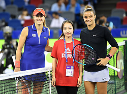 WUHAN,  Sept. 28,  2017 Alize Cornet (L) of France and Maria Sakkari (R) of Greece take a photo with a volunteer ahead of their singles quarterfinal match at 2017 WTA Wuhan Open in Wuhan, capital of central China's Hubei Province, on Sept. 28, 2017. Alize Cornet lost 0-2.  wdz) (Credit Image: © Xiong Qi/Xinhua via ZUMA Wire)